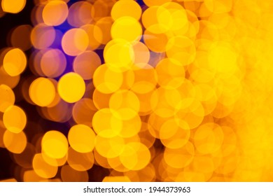 Abstract circular bokeh background of Christmaslight. bokeh from garlands. background for screensaver. Defocused lights. Blurred bokeh with yellow color lights.