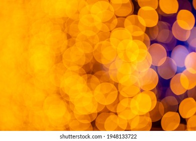 Abstract circular bokeh background of Christmaslight. bokeh from garlands. background for screensaver. Defocused lights. Blurred bokeh with yellow color lights