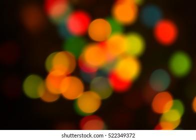 Abstract circular lights blurred bokeh holiday background of Christmas light
