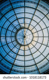 Abstract circular pattern of the glass dome of the Galleria Vittorio Emanuele II in Milan, Lombardy, Italy.