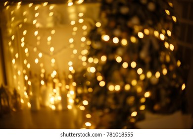 Abstract circular reflection of christmas lights on background.Holiday Christmas scene. Christmas gifts under the Christmas tree