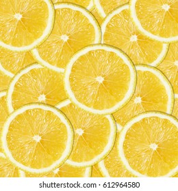 Abstract Citrus Background. Seamless pattern of yellow lemon slices