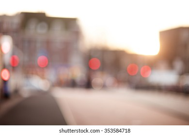 abstract city background. Cyclist, pedestrians, cars and bus crossing the bridge.Soft focus