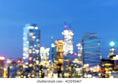 Abstract city buildings blur background with bokeh lights