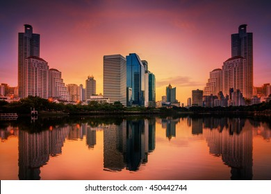 Abstract city reflection river on sunrise. Panoramic and perspective wide angle view to steel light blue background of glass high rise building skyscraper commercial modern city of future.pastel tone.