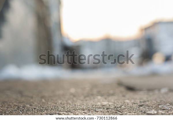 Abstract city sidewalk and street in winter.