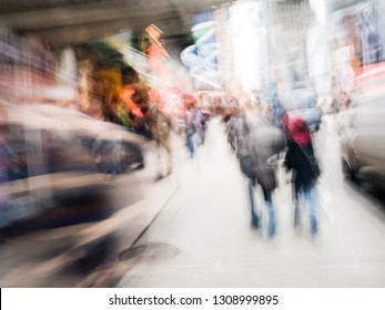 An abstract cityscape with motion blur of people in New York City.