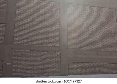 Abstract close up detail of a grey brick wall