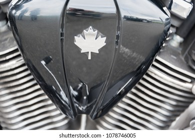 An abstract close up of a motorcycle engine with a maple leaf on it.