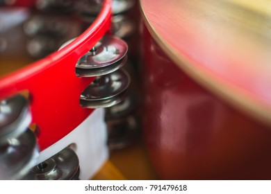 Abstract close up of a red and white tambourine , place for text.