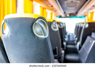 Abstract closeup back of empty seats in modern transportation comfortable bus on trip tourist travel with nobody and yellow color