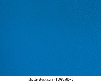 Abstract closeup of cobalt blue coloured leather background