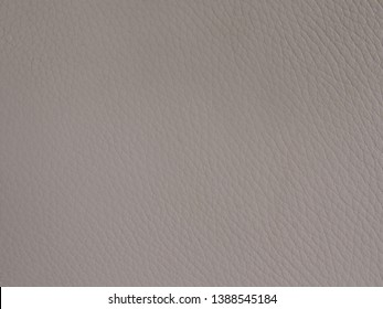 Abstract closeup of pewter coloured leather background