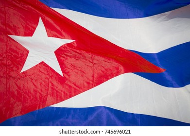 Abstract close-up view of flag of Cuba fluttering in the breeze.