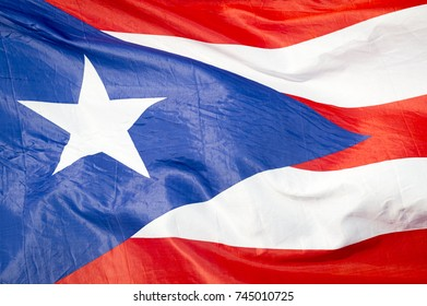 Abstract close-up view of flag of Puerto Rico fluttering in the breeze.