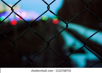 abstract Close-up wire fence on a background of trains