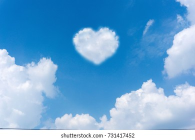 Abstract of Cloud heart shape, with blue sky on bright day background.