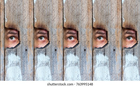 abstract collage of the human eye, voyeur spying through a hole in the old wooden fence