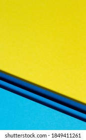 Abstract color papers geometry flat lay composition background with blue and yellow tones