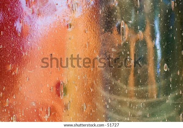 Abstract of colored glass ware seen through a seed glass window.