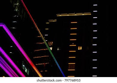 abstract colored neon lights lines of a building facade night