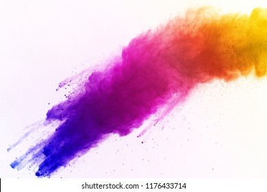 Abstract of colored powder explosion on white background. Multicolor powder splatted isolate. Colorful cloud. Colorful dust explode. Paint Holi.