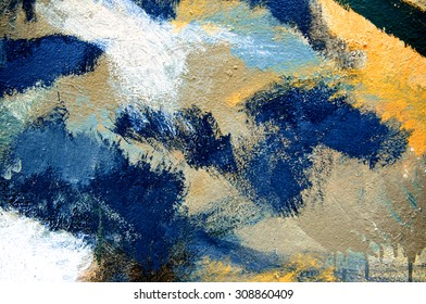 Abstract colorful acrylic paint brush on cement wall background like a earth or fun, top view.