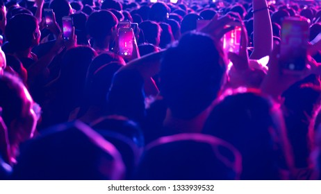abstract colorful background audience in public concert.