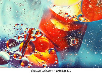 abstract colorful background, oil drops on water