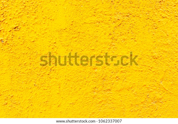 Abstract colorful cement wall yellow color. Textures and backgrounds.