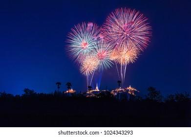 Abstract colorful firework background. Fireworks light up the sky with Khao Wang, Phranakhonkhiri, Phetchaburi, Thailand Beautiful holiday fireworks festival with twilight background, long exposure