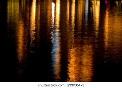 Abstract colorful light streaks reflected in the water