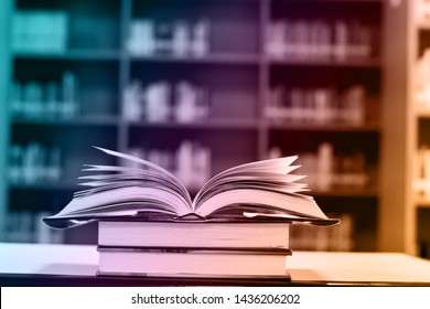 Abstract colorful of open book on wooden table and blurred background, education background.