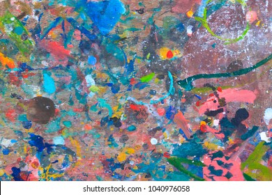 Abstract colorful paint on wood art table background.