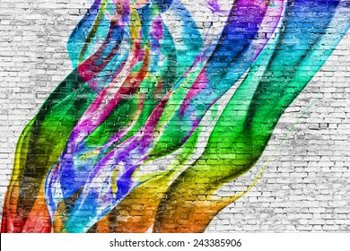 abstract colorful painting over white brick wall