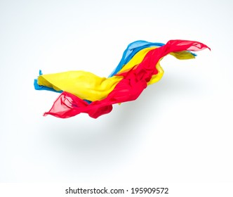 abstract colorful pieces of fabric flying, studio shot, design element