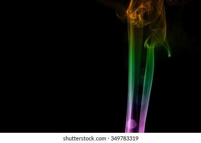 Abstract colorful smoke on black background, smoke background,colorful ink background,Violet, Green, Orange,movement of smoke