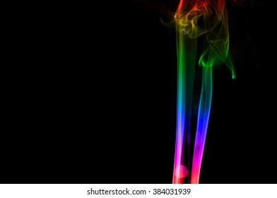 Abstract colorful smoke on black background, smoke background,colorful ink background, beautiful smoke,Movement of smoke