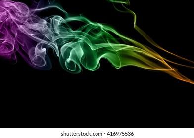 Abstract colorful smoke on black background, color background,colorful ink background,Violet, Green, Orange