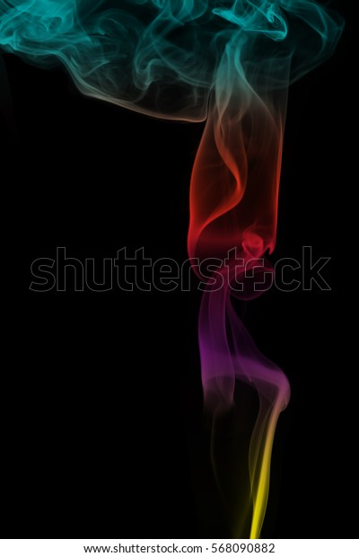 Abstract colorful smoke pattern over the black background
