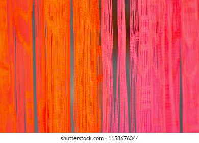 Abstract colourful hanging textiles isolated unique blurry background photo