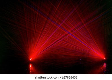 Abstract Colourful red laser show light in night