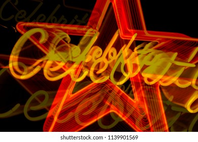 Abstract combined exposures of neon star sign at night