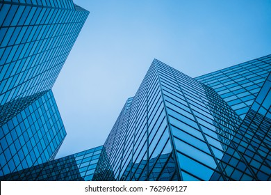 Abstract and Complex Blue Skyscraper Structure Downtown in Montreal with Sky in Background