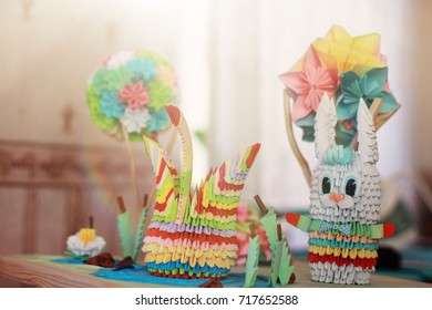 an abstract composition of homemade paper animals - a hare and a swan among paper reeds and trees. bright result of children's creativity. crafts from colored paper - Shutterstock ID 717652588
