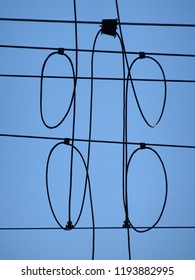 Abstract composition showing electric train overhead wire connections against blue sky background, Lower Hutt New Zealand