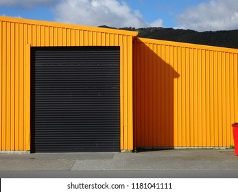 Abstract composition showing orange factory building and shadow, Seaview industrial estate, Lower Hutt New Zealand