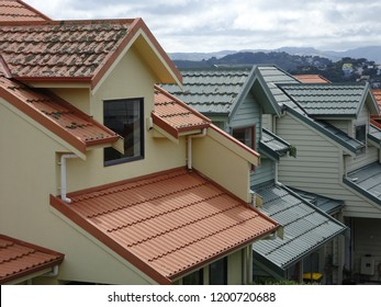 Abstract composition showing orange and grey tiled roofs on suburban houses at  Seatoun, Wellington New Zealand