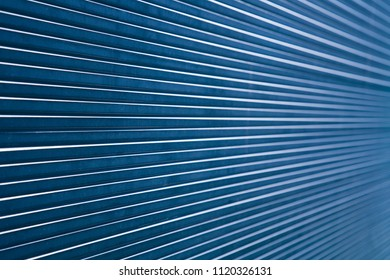 Abstract composition showing parallel, converging lines made from a stack of thick glass panes.