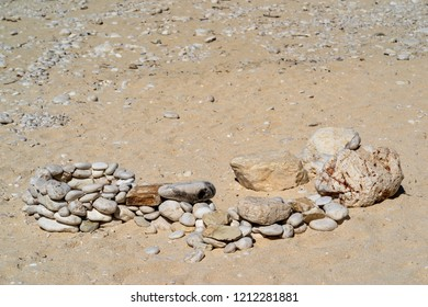abstract composition from stones on sand closeup